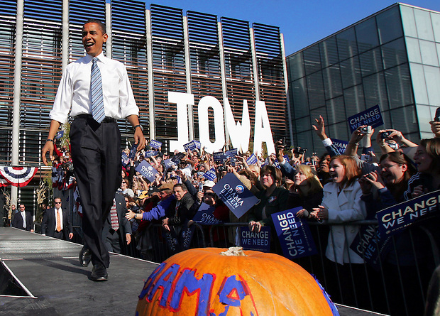 Democratic presidential nominee Sen. Barack Obama enters the stage at the outset of a campaign rally in downtown Des Moines, Friday, October 31, 2008, just four days before the general election.  Obama returned Iowa, where he won his first victory on his path to the nomination- the Iowa caucuses, some eleven months before.