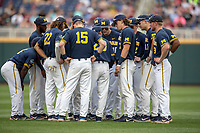 The Michigan Wolverines pregame huddle prior to taking on the Florida State Seminoles during the NCAA College World Series on June 17, 2019 at TD Ameritrade Park in Omaha, Nebraska. Michigan defeated Florida State 2-0. (Andrew Woolley/Four Seam Images)