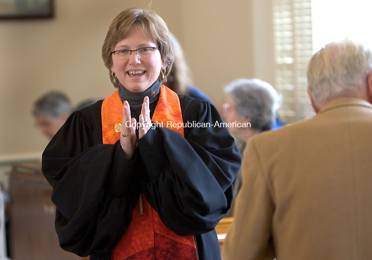 WINSTED, CT. 24 October 2010-102410SV17--Rev. Jacquelyn R. Hall greets guests before she was officially installed as pastor Winchester Center Congregational Church during a ceremony in Winsted Sunday.<br /> Steven Valenti Republican-American