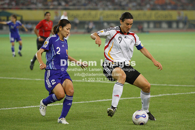 HANGZHOU, CHINA - SEPTEMBER 17:  Birgit Prinz of Germany (9) controls the ball against Hiromi Isozaki of Japan (2) during a FIFA Women's World Cup group A match September 17, 2007 in Hangzhou, China.  (Photograph by Jonathan P. Larsen)