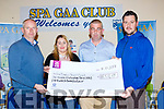 Mike O'Connell and the trustees Ivor Flynn, Tadhg Hickey and Deirdre O'Sullivan-Darcy of the Ian O'Connell Trust fund with the cheque of €118,586 in Spa GAA club on Thursday night
