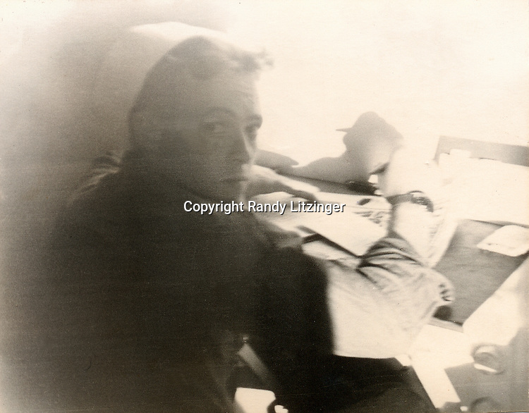 Wade Litzinger writing a letter back to the states while in C0210L on the U.S.S. Shangri-La (CV-38) - 1944 or 1945