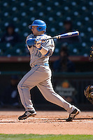 Gino Aielli #18 of the UCLA Bruins follows through on his swing versus the UC-Irvine Anteaters in the 2009 Houston College Classic at Minute Maid Park March 1, 2009 in Houston, TX.  The Anteaters defeated the Bruins 7-4. (Photo by Brian Westerholt / Four Seam Images)