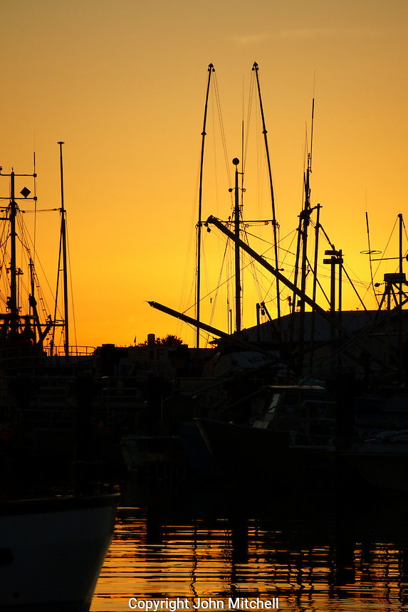 Fishing boats silhouetted by the setting sun, Steveston, British Columbia, Canada