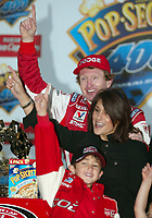 Bill Elliott celebrates with his wife, Cindy , and son, Chase, in victory lane after winning the Pop Secret 400 NASCAR Winston Cup race at Rockingham, NC on Sunday, November 9, 2003. (Photo by Brian Cleary)
