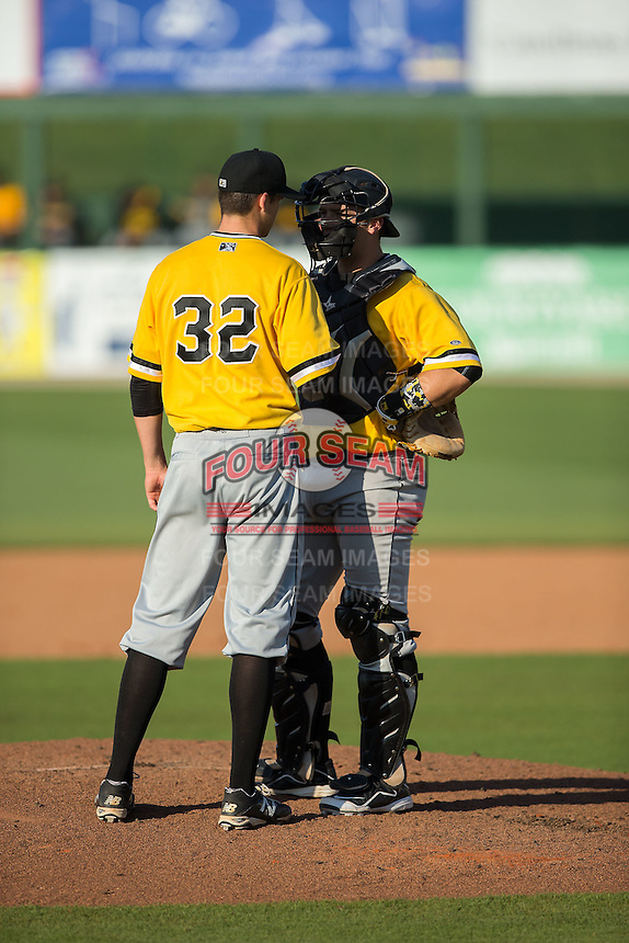 West Virginia Power catcher Taylor Gushue (17) has a chat on the mound with starting pitcher John Sever (32) during the game against the Kannapolis Intimidators at CMC-Northeast Stadium on April 21, 2015 in Kannapolis, North Carolina.  The Power defeated the Intimidators 5-3 in game one of a double-header.  (Brian Westerholt/Four Seam Images)