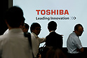 Journalists walk past a logo of Toshiba Corp. during a news conference given by Toshiba Corp. President Satoshi Tsunakawa at the company headquarters on August 10, 2017, Tokyo, Japan. Tsunakawa reported approximate 965.7 billion yen ($8.8 billion) loss for its Fiscal Year 2016 to March 31, 2017. Toshiba avoided being delisted from Tokyo Stock Exchange by announcing its delayed financial results. (Photo by Rodrigo Reyes Marin/AFLO)