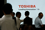 Journalists walk past a logo of Toshiba Corp. during a news conference given by Toshiba Corp. President Satoshi Tsunakawa at the company headquarters on August 10, 2017, Tokyo, Japan. Tsunakawa reported approximate 965.7 billion yen ($8.8 billion)loss for itsFiscal Year 2016 to March 31, 2017. Toshiba avoided being delisted from Tokyo Stock Exchange by announcing its delayed financial results. (Photo by Rodrigo Reyes Marin/AFLO)