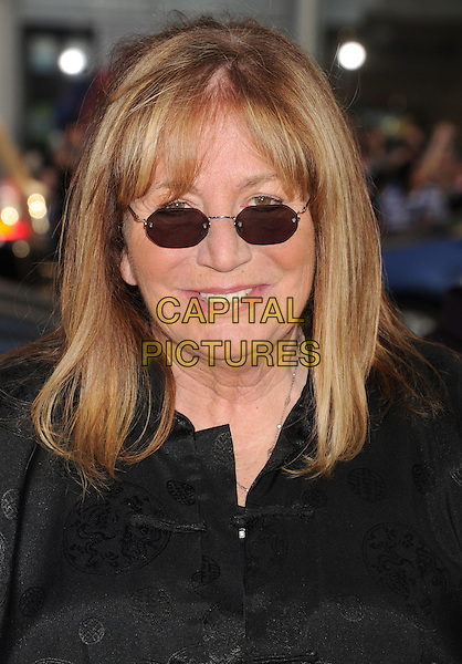 "Penny Marshall.arriving at the World Premiere of ""Ted"" at Grauman's Chinese Theatre in Hollywood, California, USA, .June 21st, 2012. .portrait headshot smiling  black sunglasses .CAP/ROT/TM.©TM/Roth Stock/Capital Pictures"