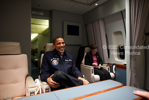 President Barack Obama wears an AF1 jacket on his first flight aboard Air Force One from Andrews Air Force Base to Newport News, Virginia 2/5/09..Mandatory Credit: Pete Souza - White House via CNP