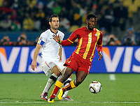 Asamoah Gyan of Ghana and Carlos Bocanegra of USA. USA vs Ghana in the 2010 FIFA World Cup at Royal Bafokeng Stadium in Rustenburg, South Africa on June 26, 2010.