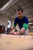"""JAMISON, PA -  NOVEMBER 1: Anthony Vaccaro, 22 hammers nails into boards at Middle Bucks Institute of Technology November 1, 2013 in Jamison, Pennsylvania. MBIT hosted an event for students called """"SkillsUSA Scare Crow Coin War and MBIT Exploration."""" The event is a fundraiser for SkillsUSA in which the proceeds are generally donated to a charity.(Photo by William Thomas Cain/Cain Images)"""