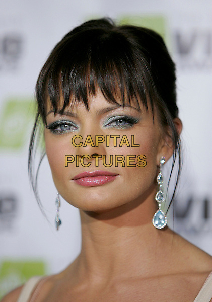 JAMIE PRESSLY.Attends The 2nd Annual Vibe Awards which will be aired on UPN. The event was taped at Barkar Hangar in Santa Monica, California,USA, November 15th 2004..portrait headshot  long drop earrings.Ref: DVS.www.capitalpictures.com.sales@capitalpictures.com.©Debbie VanStory/Capital Pictures .