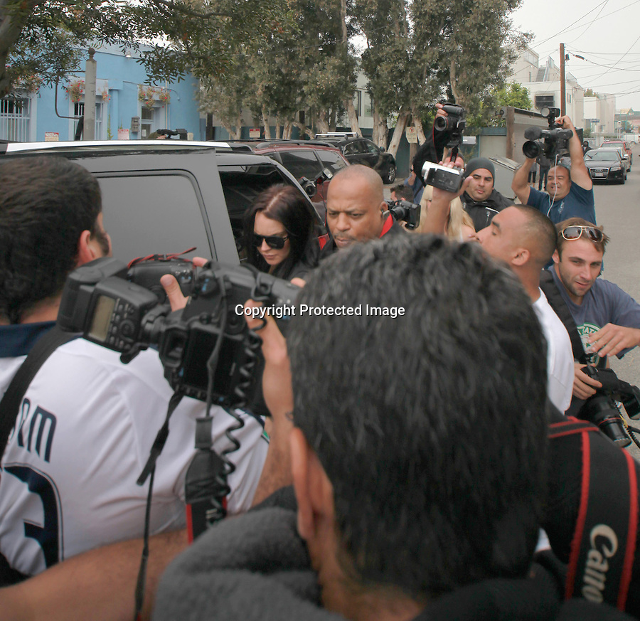 .5-4-2010..Lindsay Lohan showed up 20 minutes late to her court deposition in Venice Beach california. Lindsay was out the night before partying until 2am with her mom. .It was a complete mad house of photographers & a crazy Jewish man wearing a .Yamaka pushing all the photographers & a big black body guard screaming to move...AbilityFilms@yahoo.com.805-427-3519.www.AbilityFilms.com