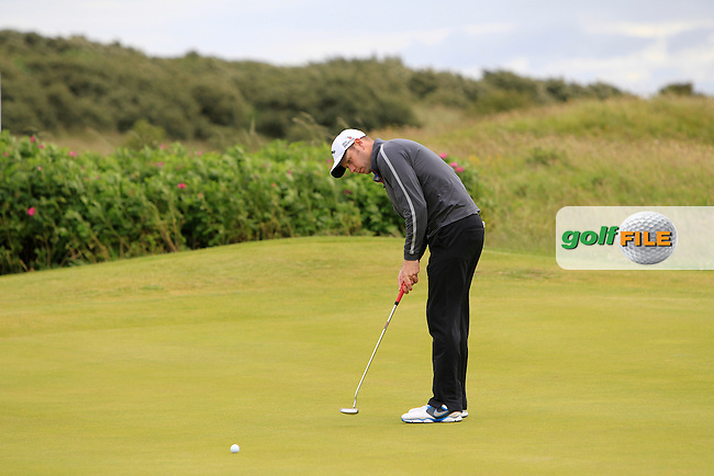David Sutton (Lurgan) on the 11th green during the Semi-Finals of the North of Ireland Amateur Open Championship at Royal Portrush, Dunluce Course on Friday 17th July 2015.<br /> Picture:  Golffile | Thos Caffrey
