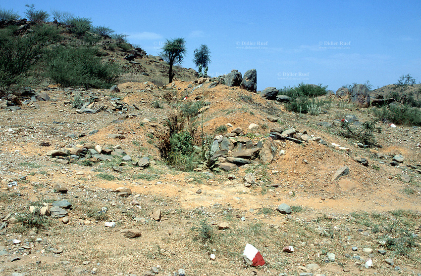 Eritrea. Southern Debud Zone. On the road to Tsorona.                                                                                                                                                                                                                             The small town was occupied by ethiopian troops and heavily destroyed during the war between Eritrea and Ethiopia on the border dispute (1999 to 2001). Ethiopian trenches on the front line, which was just was 10 km away from Tsorona. The zone was a real trench warfare. The entirea area (hills and fields) is still heavily mined and extremely dangerous for the life of men and animals. The stones painted in red and white mean that the area is unsafe. © 2002 Didier Ruef
