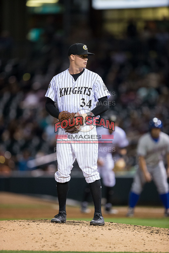 Charlotte Knights relief pitcher Zack Burdi (34) looks to his catcher for the sign against the Durham Bulls at BB&T BallPark on May 15, 2017 in Charlotte, North Carolina. The Knights defeated the Bulls 6-4.  (Brian Westerholt/Four Seam Images)