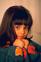 Portrait of a little girl with dark brown eyes.