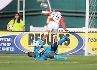 D.C. United goalkeeper Bill Hamid (28) goes down to make a play against Toronto FC forward Reggie Lambe (19) D.C. United defeated Toronto FC 3-1 at RFK Stadium, Saturday May 19, 2012.