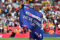 Tranmere's Jake Caprice celebrates at the final whistle with the 'We're Going Up' banner during Newport County vs Tranmere Rovers, Sky Bet EFL League 2 Play-Off Final Football at Wembley Stadium on 25th May 2019
