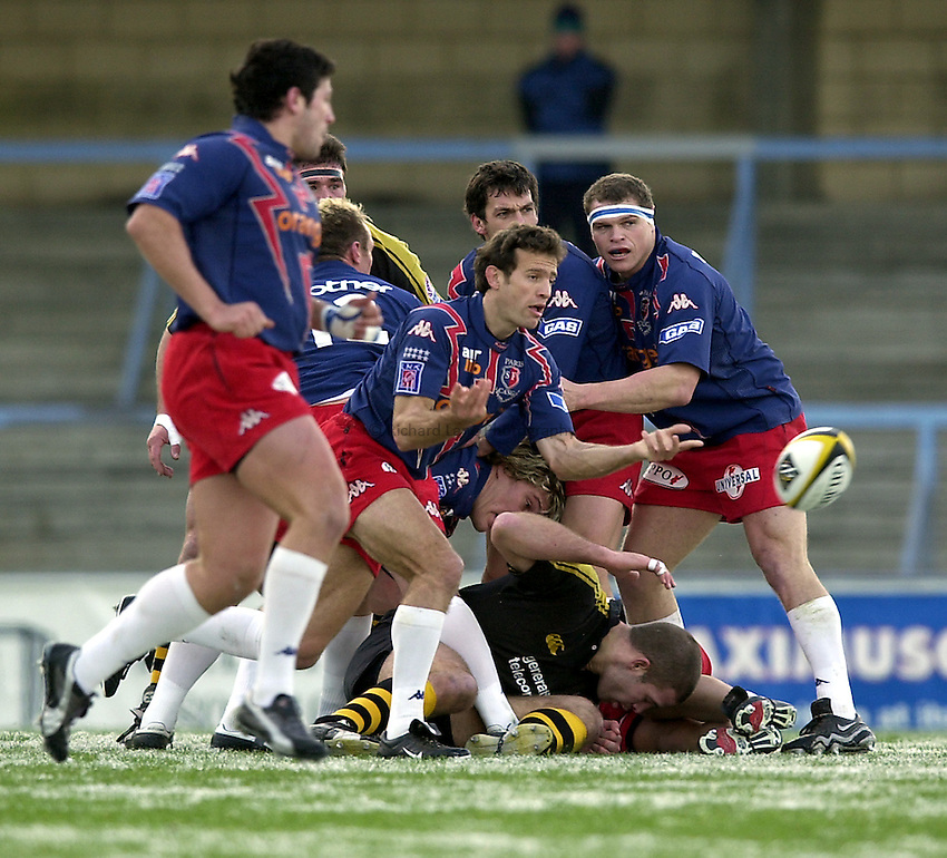 Photo. Richard Lane. .London Wasps v Stade Francais. Parker Pen Challenge Cup. 12/01/2003.Fabien Galthie gets the ball away.