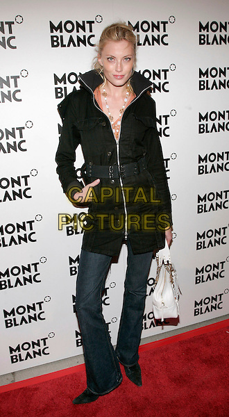 JENNIFER OLSAN.At event to launch Montblanc Diamond to Celebrate its 100th Anniversary at New Space, New York, NY, USA..March 14th, 2006.Photo: Jackson Lee/Admedia/Capital Pictures.Ref: JL/ADM.full length jeans denim black jacket white purse bag.www.capitalpictures.com.sales@capitalpictures.com.© Capital Pictures.