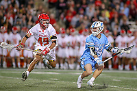 College Park, MD - April 27, 2019: John Hopkins Bluejays attack Jack Keogh (24) is defended by Maryland Terrapins midfielder Michael Chiaramonte (49) during the game between John Hopkins and Maryland at  Capital One Field at Maryland Stadium in College Park, MD.  (Photo by Elliott Brown/Media Images International)