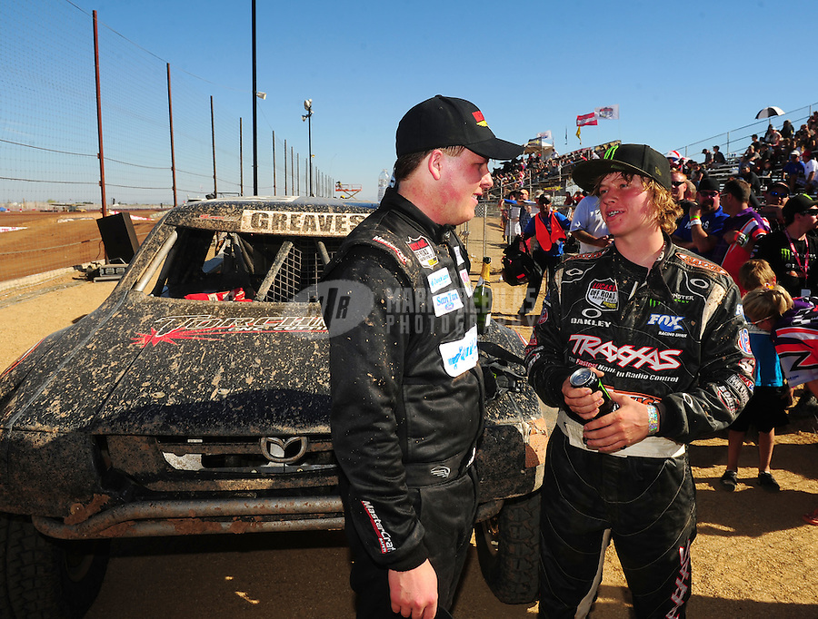 Apr 16, 2011; Surprise, AZ USA; LOORRS driver C.J. Greaves (right) talks with Jacob Person (92) during round 3 at Speedworld Off Road Park. Mandatory Credit: Mark J. Rebilas-.