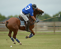 NWA Democrat-Gazette/ANDY SHUPE<br /> Greg Summers prepares to strike the ball Saturday, Sept. 8, 2018, during the 29th annual Polo in the Ozarks at the Buell Farm in Goshen. This event features a polo match, games, vendors, music and food to benefit Life Styles Inc.