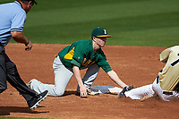 Siena Saints shortstop Tyler Martis (1) tags Ryan Crile (7) sliding into second base during a game against the UCF Knights on February 21, 2016 at Jay Bergman Field in Orlando, Florida.  UCF defeated Siena 11-2.  (Mike Janes/Four Seam Images)