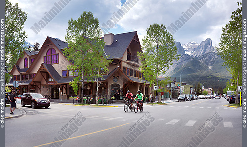 Downtown city scenery of people on streets of Canmore, town in Alberta Rockies, Bow valley with Rocky mountains in the background. Summer day. Canmore, Alberta, Canada.