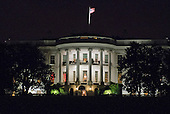 """South Portico of the White House is lit up during the BET's """"Love and Happiness: A Musical Experience"""" performance on the South Lawn of the White House in Washington, DC on Friday, October 21, 2016.<br /> Credit: Ron Sachs / Pool via CNP"""