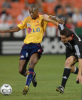 Monarcas Morelia midfielder Wilson Tiago (5) fights for possession of the ball against DC United forward Rod Dyachenko (15). Monarcas Morelia tied DC United 1-1 in the SuperLiga opening match in group B, at RFK Stadium in Washington DC, Wednesday July 25, 2007.