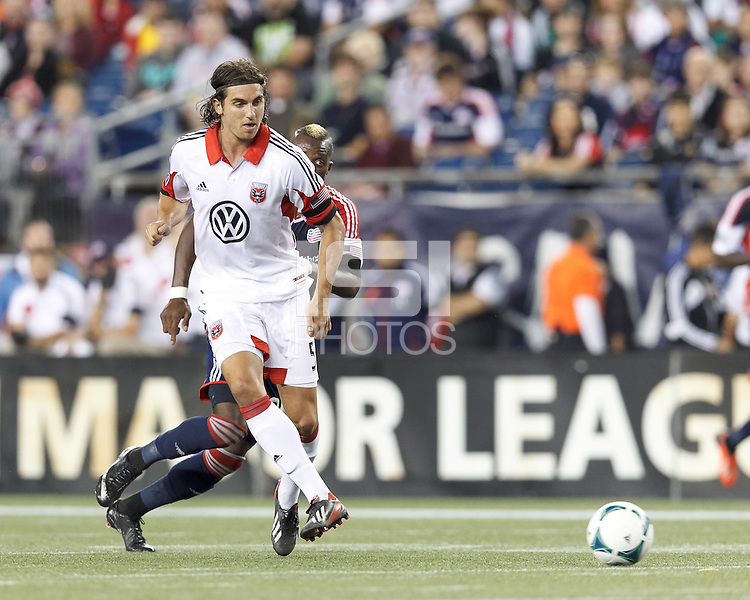 D.C. United defender Dejan Jakovic (5) passes the ball.  In a Major League Soccer (MLS) match, the New England Revolution (blue) defeated D.C. United (white), 2-1, at Gillette Stadium on September 21, 2013.