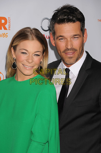 LeAnn Rimes & Eddie Cibrian.Trevor Live at The Hollywood Palladium in Hollywood, California, USA..December 4th, 2011.half length dress black suit stubble facial hair couple green earrings .CAP/ROT/TM.©Tony Michaels/Roth Stock/Capital Pictures