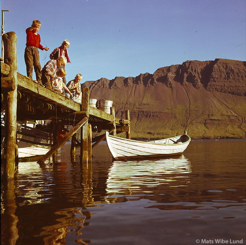 Strákar að veiða á bryggju, Neskaupstaður. /.Boys fishing in Neskaupstadur..-.Photo from the AUGNAGAMAN anniversary exhibition.
