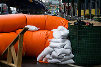 "NEW YORK, NY - AUGUST 4: Water barriers used to prevent flooding are seen at the South Street Seaport as city gets ready for tropical storm Isaias on August 4, 2020 in New York City. The Tri-State area ""New York, New Jersey and Connecticut"" is preparing for torrential rain, strong winds from Tropical storm Isaias. (Photo by Eduardo MunozAlvarez/VIEWpress)"