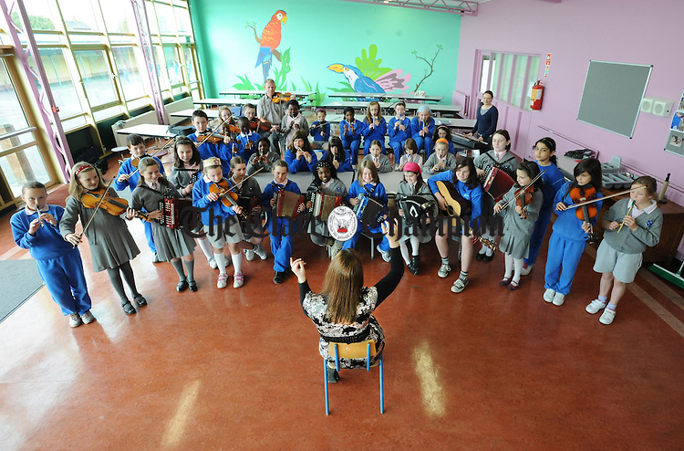 Playing a few tunes during music practice at the Holy Family National School in Ennis. Photograph by Declan Monaghan