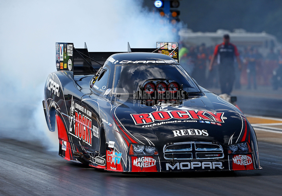 Aug. 16, 2013; Brainerd, MN, USA: NHRA funny car driver Matt Hagan during qualifying for the Lucas Oil Nationals at Brainerd International Raceway. Mandatory Credit: Mark J. Rebilas-