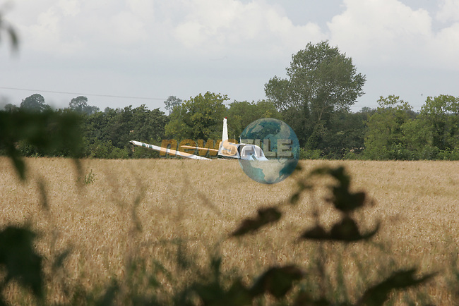 the downed light aircraft in the grain field 500 meters away from the trim airstrip..Two occupants were removed by ambulance to hospital....Photo: Fran Caffrey/ Newsfile.COPY Joe McCabe
