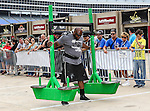 World's Strongest man contestant, Mark Felix, performs before the Nascar Sprint Cup Series Samsung Mobile 500 race at Texas Motor Speedway in Fort Worth,Texas. Sprint Cup Series driver Greg Biffle (16) wins the Samsung Mobile 500 race.