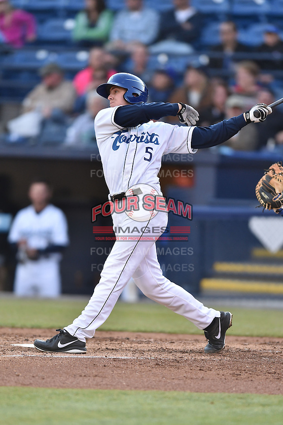 Asheville Tourists catcher Robbie Perkins (5) swings at a pitch during a game against the Lexington Legends on May 1, 2015 in Asheville, North Carolina. The Tourists defeated the Legends 4-1. (Tony Farlow/Four Seam Images)