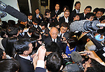May 11th, 2011, Tokyo, Japan - Satoshi Ozawa, vice president of Toyota Motor Co., is mobbed by the media after a news conference at the automaker' s head office in Tokyo on Wednesday, May 11, 2011. Toyota sustained damage totaling more than 100 billion yen from the March 11 earthquake and tsunami that devastated Japan's northeastern region. The world's largest carmaker posted a 77% drop in net profit for the January-to-March quarter due to production disruptions and the effects of the strong yen. (Photo by Natsuki Sakai/AFLO) [3615] -mis-