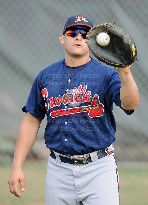 Catcher Nick DeSantiago (18) of the Danville Braves, Appalachian League affiliate of the Atlanta Braves, prior to a game against the Johnson City Cardinals on August 19, 2011, at Howard Johnson Field in Johnson City, Tennessee. DeSantiago was Atlanta's fifth-round pick in the 2011 First-Year Player Draft. Danville defeated Johnson City, 5-4, in 16 innings. (Tom Priddy/Four Seam Images)