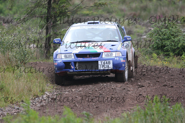 Fraser MacNicol - Daniel Johnstone in their Mitsubishi Lancer Evo 6 near Junction 6 on SS1 Ae East.....