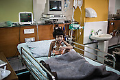 3 year old Lubiana cries as she sits on her bed at the Intensive Therapy Unit of the Pediatric Section of the Narayana Hrudayalaya in Bangalore, Karnataka, India. Photo: Sanjit Das/Panos