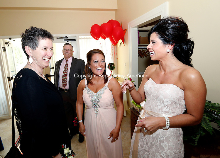 Goshen, CT- 08 May 2015-050815CM07- Barbara Spiegel, left, executive director at Susan B. Anthony Project, and named Woman of the Year by the United Way,  shares a laugh with Cailin Cerruto, center and Kara Paganini-Muth both co-chairs during The United Way Women's Leadership Initiative Woman of the Year Gala at the Torrington Country Club in Goshen on Friday night.  Susan B. Anthony is a non-profit agency that provides crisis and support for victims of domestic violence, sexual assault and abuse. Christopher Massa Republican-American