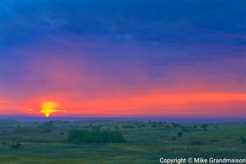 Stormy sky at dawn overlooking the prairie landscape from the top of the Great Sandhills<br />