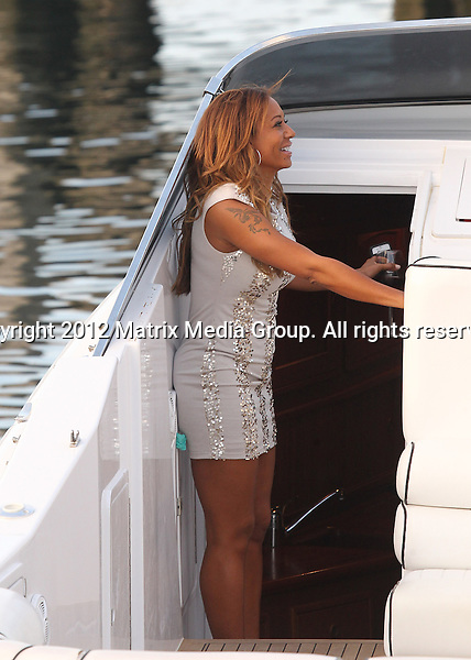 17 OCTOBER 2012 SYDNEY AUSTRALIA ..EXCLUSIVE ..Former Spice Girl and X Factor judge Melanie Brown (Mel B) is pictured with her husband Stephen Belafonte and a friend aboard their motor cruiser 'Timeout' enjoying a glass of red wine and a beer as they wait for friends to join them at Woolloomooloo wharf. Mel was in a great mood and ready to party as she did a little dance on the back deck as she waved eagerly to her friends. They enjoyed a short cruise around the harbour before returning to their Vaucluse home......*No internet without clearance*.MUST CALL PRIOR TO USE ..+61 2 9211-1088.Matrix Media Group.Note: All editorial images subject to the following: For editorial use only. Additional clearance required for commercial, wireless, internet or promotional use.Images may not be altered or modified. Matrix Media Group makes no representations or warranties regarding names, trademarks or logos appearing in the images.