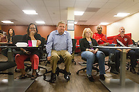 San Francisco, CA - Tuesday, July 1, 2014: Employees at Arthur J. Gallagher insurance company watch the end of the USA vs. Belgium World Cup Round of 16 game in San Francisco.